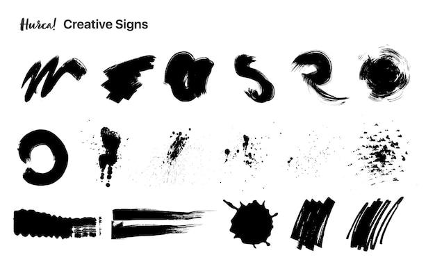 Raccolta di pennellate di vernice nera di diverse forme realizzate con pennello asciutto