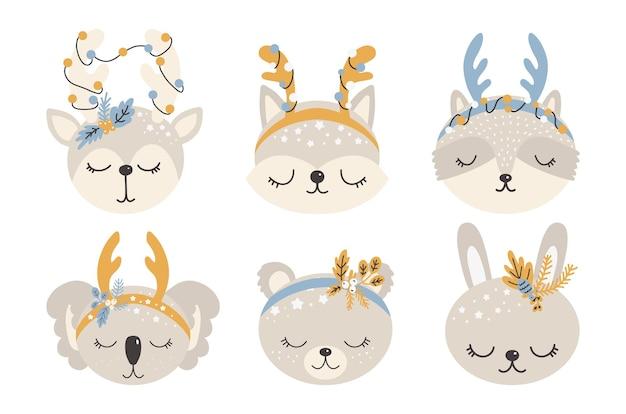Collezione di simpatici animali natalizi, illustrazioni di buon natale di cervi, volpi, procioni, lepri, gatti e koala con accessori invernali.