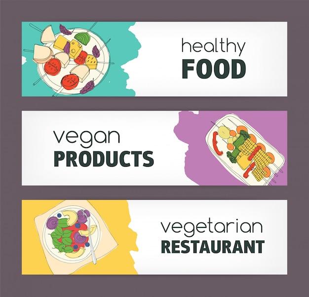 Raccolta di modelli di banner orizzontali colorati con disegnati a mano piatti vegani e vegetariani che si trovano sui piatti.