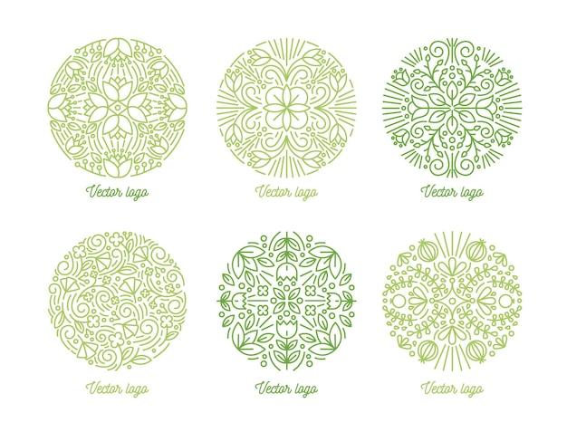 Collezione di ornamenti orientali circolari curvi disegnati con linee di contorno verdi su bianco.