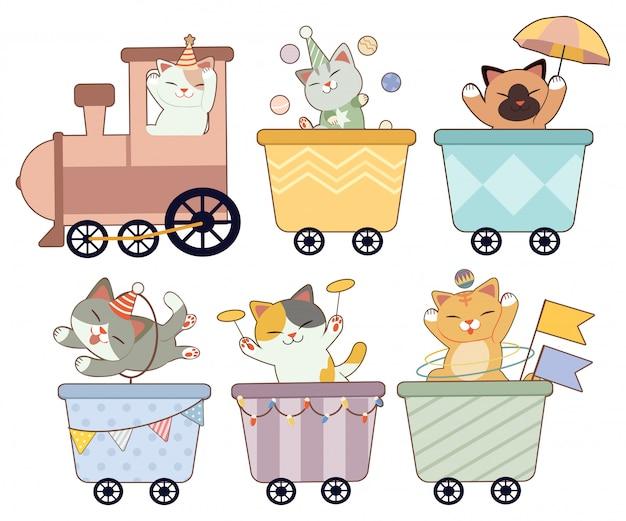 La collezione di simpatici gatti nel treno del circo su bianco