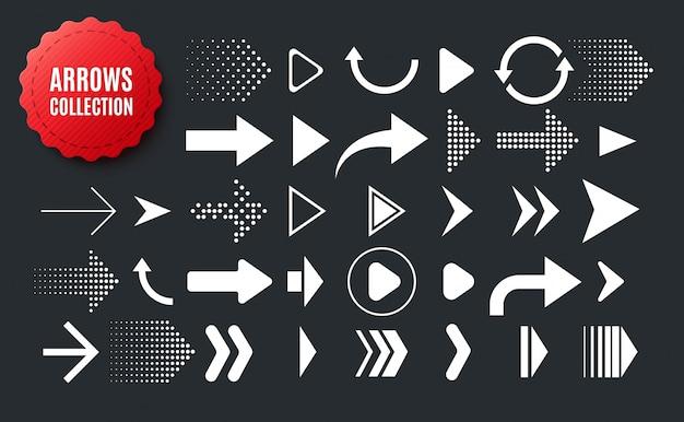 Raccolta di frecce di forma diversa. insieme delle icone delle frecce isolate sul nero
