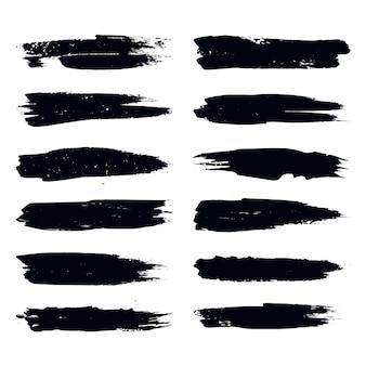 Raccolta di tratti di pennello di vernice nera astratta disegnata a mano insieme di cornici di forme isolate su bianco