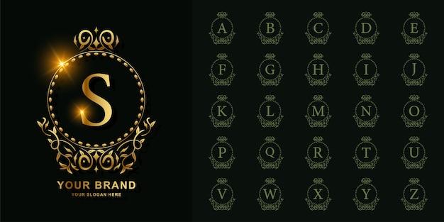 Alfabeto iniziale di raccolta con ornamento di lusso o modello di logo dorato cornice floreale cerchio.