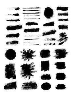 Raccolta di pennellate di inchiostro. insieme delle spazzole di lerciume di vettore. texture sporche di banner, scatole, cornici ed elementi di design. oggetti dipinti isolati su sfondo bianco
