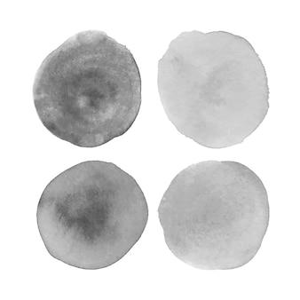 Raccolta di macchie di acquerello grigio chiaro isolate su sfondo bianco