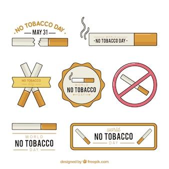 Raccolta di nessun giorno di tabacco etichette con dettagli in arancione