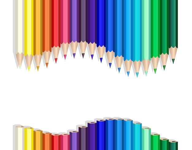 Matite colorate che fanno un'onda sul bianco