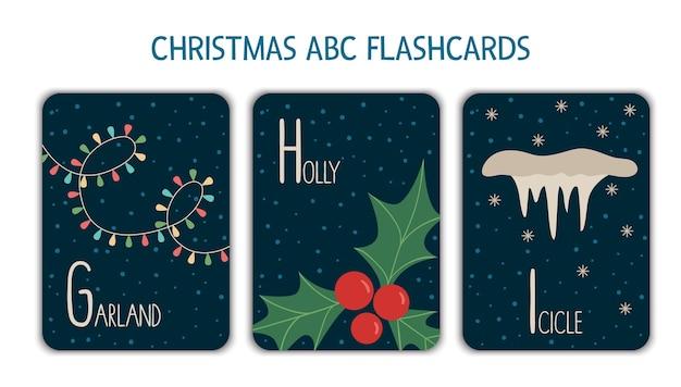 Alfabeto colorato lettere g, h, i. flashcard fonetica. simpatiche cartoline abc a tema natalizio per insegnare a leggere con divertenti ghirlande, agrifogli, ghiaccioli. attività festiva di capodanno.