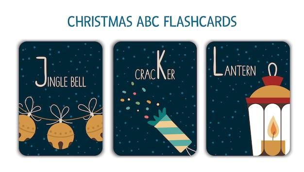 Alfabeto colorato lettere j, k, l. phonics flashcard. simpatiche cartoline abc a tema natalizio per insegnare a leggere con divertenti campanelli, cracker, lanterna. attività festiva di capodanno.