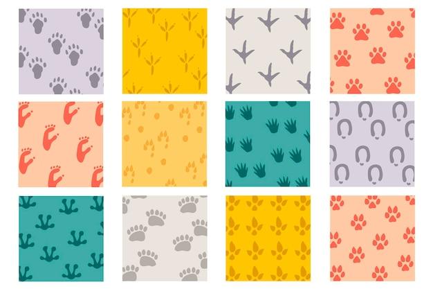 Set piatto colorato di impronte di tracce di animali divertenti. stampa zampe impostate.