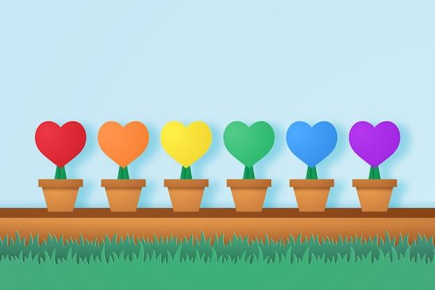 Cuore colorato in vaso di fiori con erba in stile arte della carta