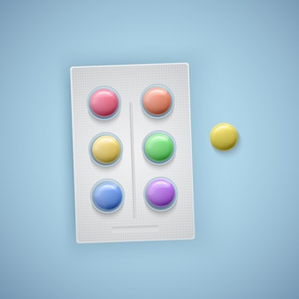 Compresse colorate con i colori dell'arcobaleno, pillole di vitamine per bambini,