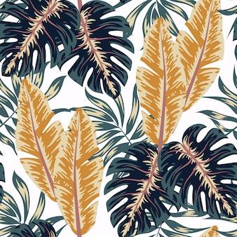 Modello senza saldatura tropicale colorato. modello astratto creativo con piante tropicali