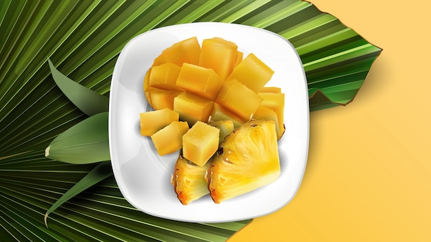 Composizione di fette di ananas e mango a dadini su un piatto bianco e foglie.