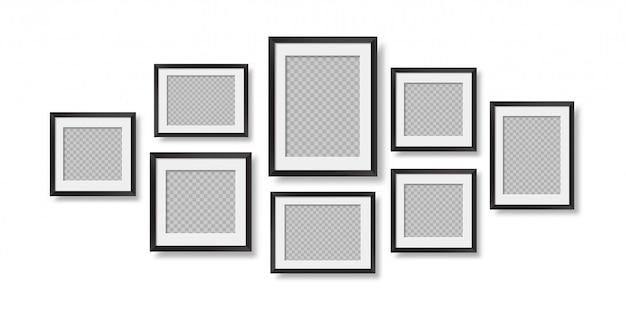 Composizione di cornici per foto neri realistici sul muro.