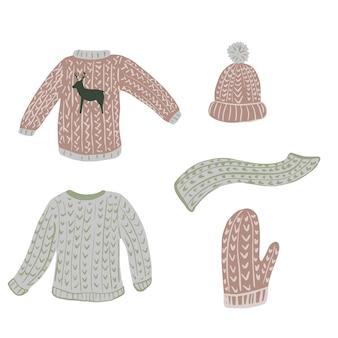 Composizione brutto maglione su sfondo bianco. abbigliamento stagione kit scandinavo da maglione, guanto, berretto, sciarpa e fogliame schizzo disegnato a mano in stile doodle.