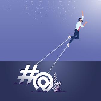 Concetto di dipendenza da social media e attenzione online-uomo d'affari incatenato a una grande icona commerciale e forma