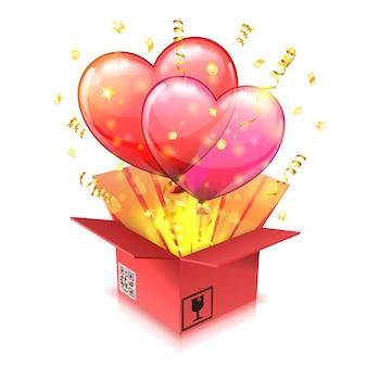 Concetto per san valentino con palloncino trasparente in forma di cuori, decollo dalla confezione regalo con stelle filanti e coriandoli.