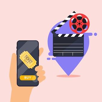 Concetti di ordinazione di biglietti per il cinema online. mano che tiene il telefono cellulare intelligente con app di acquisto online.