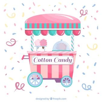 Sfondo di confetti con carrello di caramella di cotone