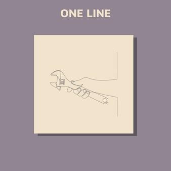 Disegno di linea continuo della mano che tiene la chiave regolabile