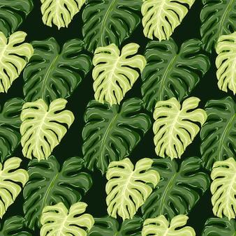Motivo senza cuciture a contrasto con stampa di foglie di monstera di palma verde pastello. sfondo scuro.