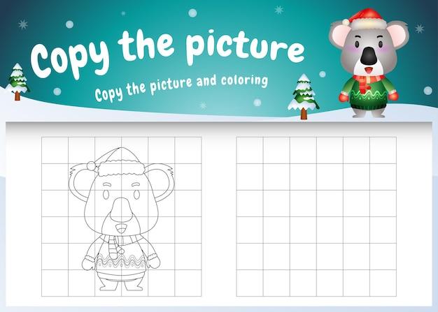 Copia l'immagine del gioco per bambini e la pagina da colorare con un simpatico koala usando il costume di natale