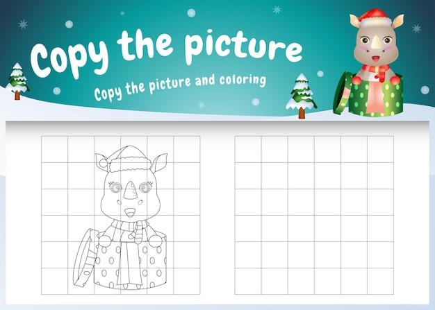 Copia l'immagine del gioco per bambini e la pagina da colorare con un simpatico rinoceronte usando il costume di natale
