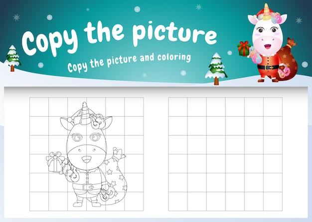 Copia l'immagine del gioco per bambini e la pagina da colorare con un unicorno carino usando il costume di babbo natale
