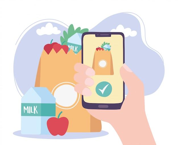 Pandemia di coronavirus, servizio di consegna, mano con ordine di generi alimentari smartphone
