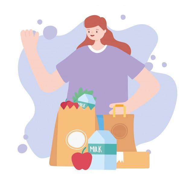 Pandemia di coronavirus, servizio di consegna, donna con sacchetto della spesa pieno di cibo
