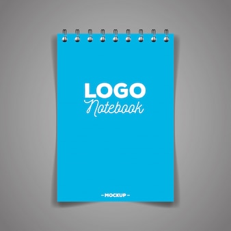 Marchio di identità aziendale, con taccuino di colore blu copertina