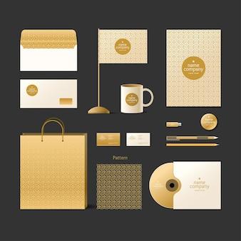 Modello di identità aziendale. logo ed elementi di design. stile dorato su sfondo scuro.