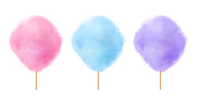 Set di zucchero filato. caramelle di cotone rosa viola blu realistiche su bastoncini di legno.