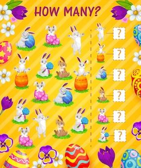 Conteggio del gioco per bambini di quanti modelli di uova di pasqua e conigli