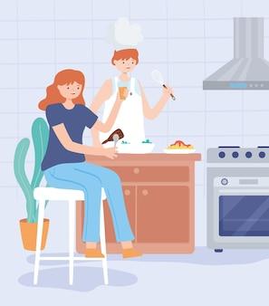 Coppia che cucina in cucina