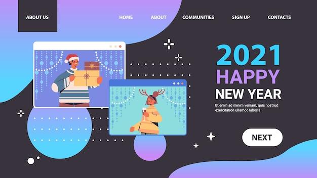 Coppia discutere durante la videochiamata uomo donna divertirsi felice anno nuovo buon natale vacanze celebrazione concetto web browser finestre auto isolamento comunicazione online orizzontale ritratto vettoriale