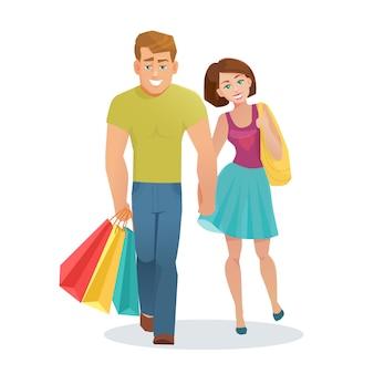 Coppia uomo e donna che cammina con i sacchetti di shopping