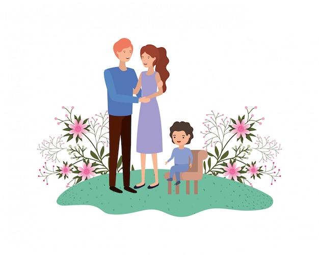 Coppia di genitori con figlio seduto sulla sedia