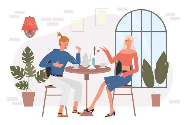 La gente della coppia beve il caffè nella caffetteria alla data