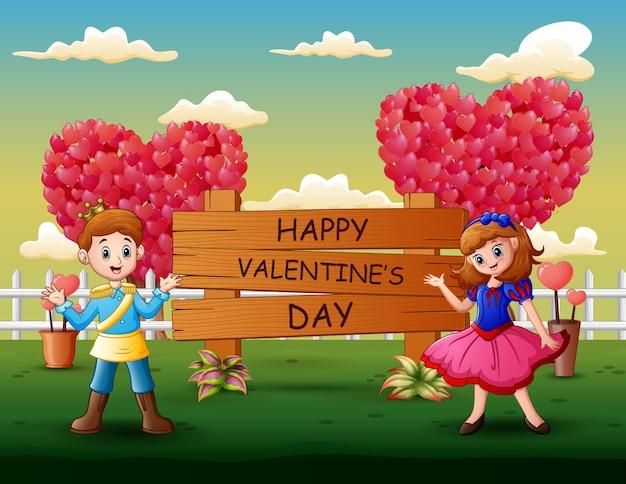 Un paio di principe e principessa che presentano happy valentines day
