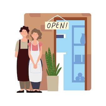 Coppia di venditori in piedi presso l'illustrazione del negozio porta aperta