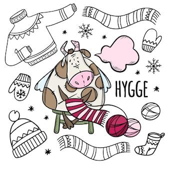 Mucca maglia cose calde invernali. insieme dell'illustrazione disegnata a mano del toro di vacanza invernale