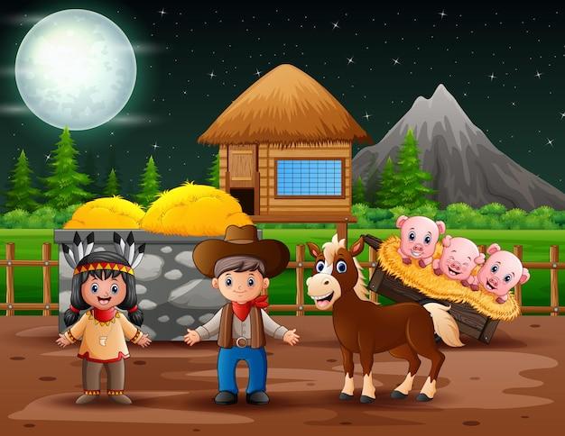 Un cowboy e una ragazza indiana americana nella fattoria