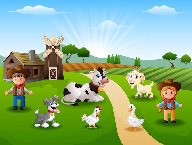 Il cowboy e la cowgirl alla fattoria con gli animali