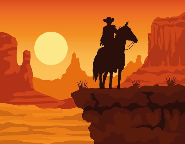 Sagoma di figura del cowboy nella scena del paesaggio al tramonto del cavallo