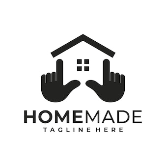 Creativo del modello di progettazione del logo della casa e della mano