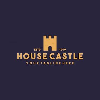 Design del logo del castello di casa creativa