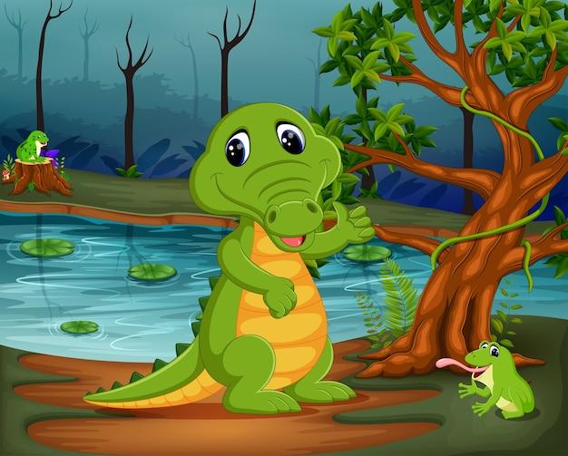 Coccodrillo e rana nella giungla con scena del lago